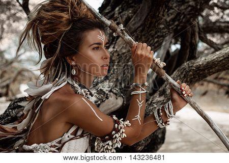 Attractive wild boho woman close up portrait