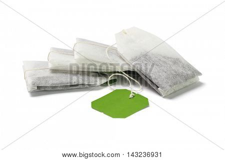 Stack of Green Tea Bags with Blank Tag on White background