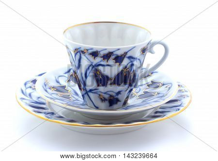 Porcelain Cup, Plate And Saucer On A White Background