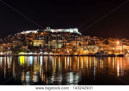 Amazing night photo of embankment and old town of Kavala, East Macedonia and Thrace, Greece poster