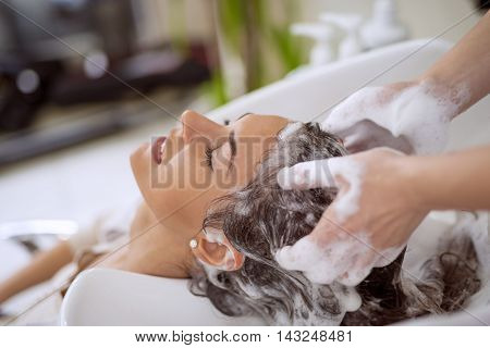 Portrait of women which wash hair in a beauty salon.Hairdresser washing hair.