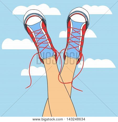 legs in sneakers on the background of the sky with clouds. funky colored shoes gumshoes fashion sneakers isolated.