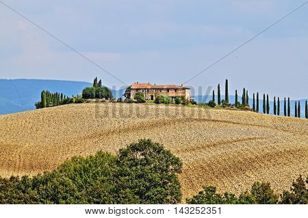 Landscape in Tuscany with luxury villa and cipress - HDR