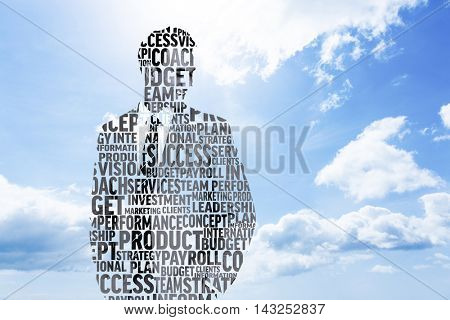 Businessman in buzzwords against blue sky