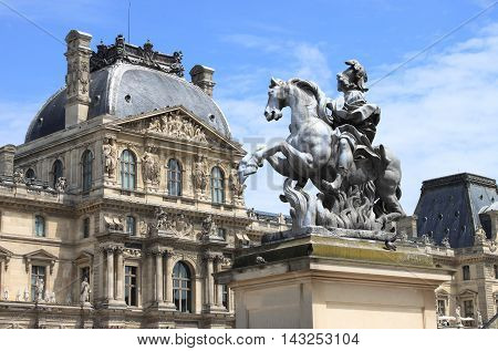 Louvre Museum and the Louis XIV Equestrian statue. Paris, France