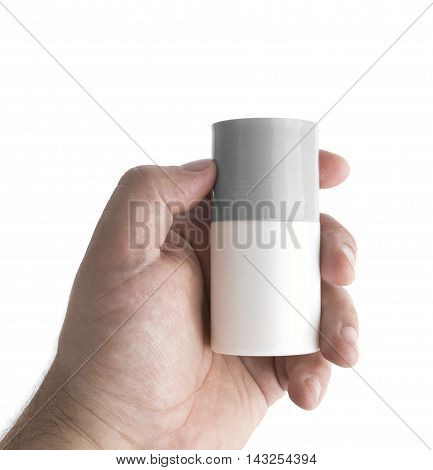 Tube deodorant in men hand isolated. With clipping path.