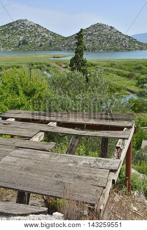 The landscape near the village of Blace in the coastal Dubrovnik-Neretva county of Croatia. A disused wooden platform can be seen in the foreground.