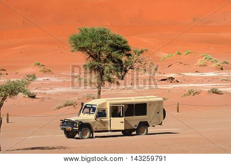 SOSSUSVLEI NAMIBIA - JAN 29 2016: Safari car in the Namib-Naukluft National Park. The most visited place in Namibia