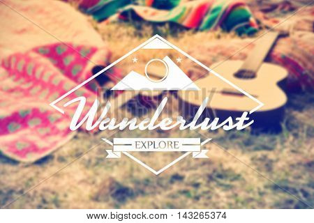 Wanderlust word against empty campsite at music festival