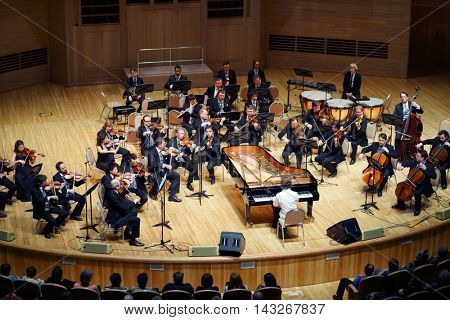 MOSCOW - APR 20, 2015: Orchestra on stage at concert devoted to 100th anniversary of David Ashkenazy in House of Music, Svetlanov hall