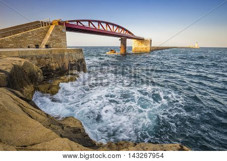 Valletta, Malta - St. Elmo Breakwater bridge and the entrance of the Grand Harbour of Valletta at sunset