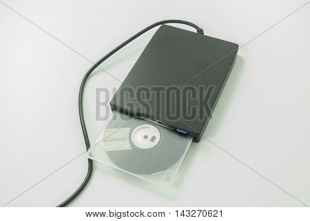 black external usb floppy disk drive with a white disk insideon white background
