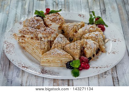 beautiful dessert with cake and berry on wood background