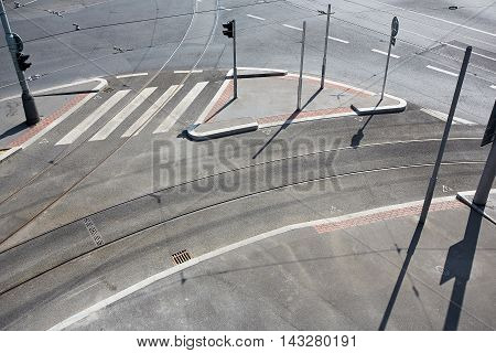 Empty city crossroad with track, pavement and road. Traffic sign with stoplights