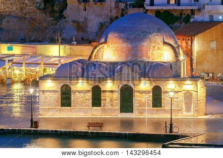 Scenic view Venetian embankment in Chania with the Mosque of Hassan Kuchuk Pasha at night. Crete, Greece. poster