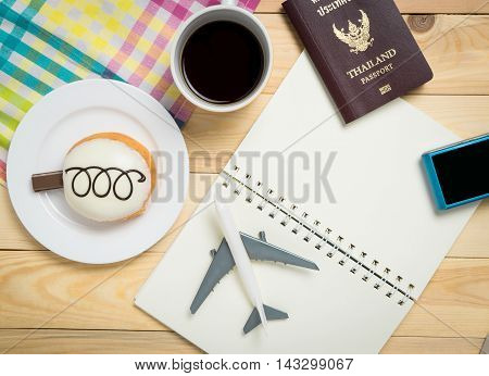 Travel planing equipment for Hipster explorer. Travel Diary for travel blogger to write their vacation trip and review. Traveler items on wooden cafe table.