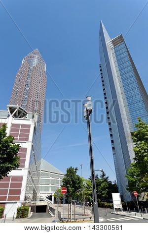 FRANKFURT AM MAIN GERMANY - AUGUST 7 2015: The Trade Fair Tower Messeturm and the Kastor Tower in the Gallus district next to Frankfurt Trade Fair Grounds. Messeturm is the second tallest building in the city.
