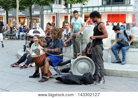 FRANKFURT AM MAIN GERMANY - AUGUST 7 2015: Street performers on Zeil one of the most famous and busiest shopping streets in Germany.