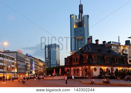FRANKFURT AM MAIN GERMANY - AUGUST 7 2015: Hauptwache square illuminated in the evening. Hauptwache is a central point and one of the most famous plazas of Frankfurt.