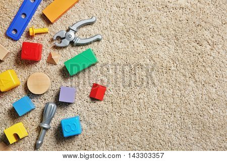Children's toys on carpet, top view