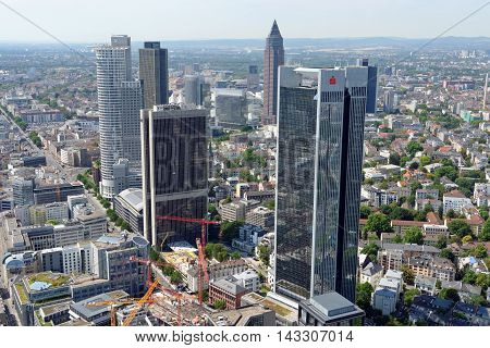 FRANKFURT AM MAIN GERMANY - AUGUST 6 2015: Aerial view of the central business district from the observatory deck of the Mainn tower. Frankfurt is the largest financial center in continental Europe.