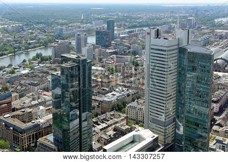 FRANKFURT AM MAIN GERMANY - AUGUST 6 2015: Aerial view of the central business district from the observatory deck of the Mian tower. Frankfurt is the largest financial centre in continental Europe.