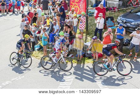Col du Glandon France - July 23 2015: Stef Clement of IAM TeamThibaut Pinot of FDJ Team and Izagirre Insausti of Movistar Team riding in a beautiful curve at Col du Glandon in Alps during the stage 18 of Le Tour de France 2015.