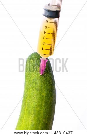 syringe with cucumber  isolated on white background