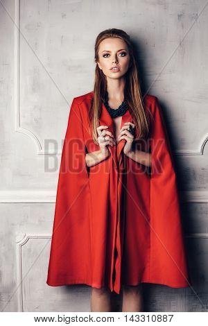 Fashion Young Beautiful Woman In Red Coat