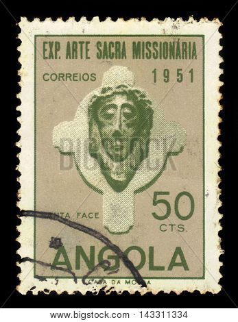 ANGOLA - CIRCA 1952: A stamp printed in Angola shows a head of Christ, exhibition of sacred missionary art issue, grey, olive green, circa 1952