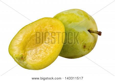 Greenish-yellow plums isolated on a white background