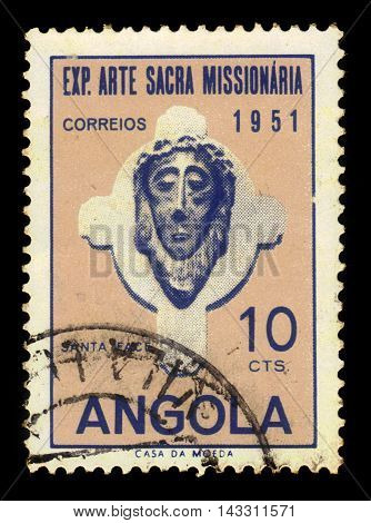 ANGOLA - CIRCA 1952: A stamp printed in Angola shows a head of Christ, exhibition of sacred missionary art issue, ochre, violet blue, circa 1952
