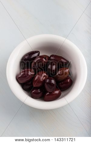 Bowl of Kalamata olives isolated on white.