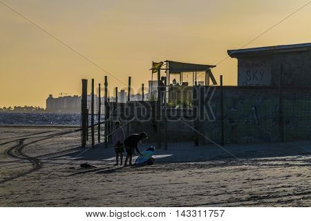 MONTEVIDEO, URUGUAY, DECEMBER - 2015 - Backlight sunset scene at one of the beaches of Montevideo Uruguay