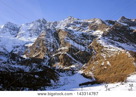 Mount with Fee Glacier (Fee Gletscher) covered with snow creating a beautiful winter landscape in Saas Fee, Switzerland.