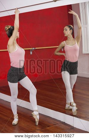 Ballerina Performing While Looking At Self In Mirror