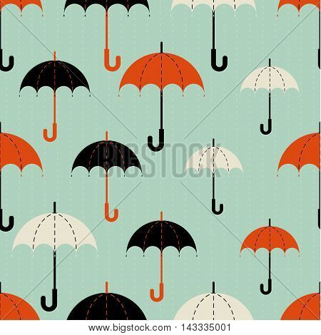 Seamless texture. Autumn. Depicts the umbrellas of the different  size .Umbrella in three colors : black, red and beige .Umbrellas in the rain. Umbrellas on a blue background.