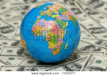 Globe Isolated On The Background Of Dollar Bank Notes