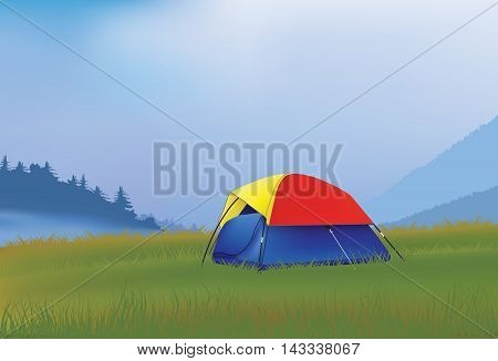 Camping tent for two in the mountains in the foggy morning.