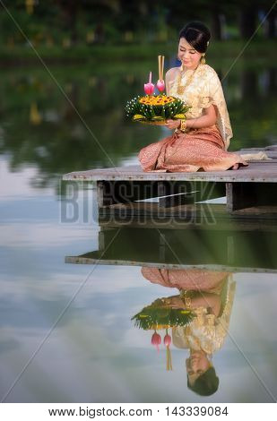Loy Krathong Traditional Festival Thai woman hold kratong Thailand