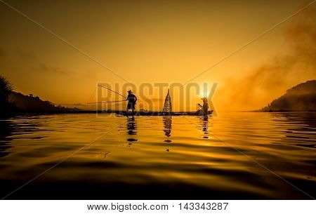 Fisherman in action when fishing in the lake Thailand