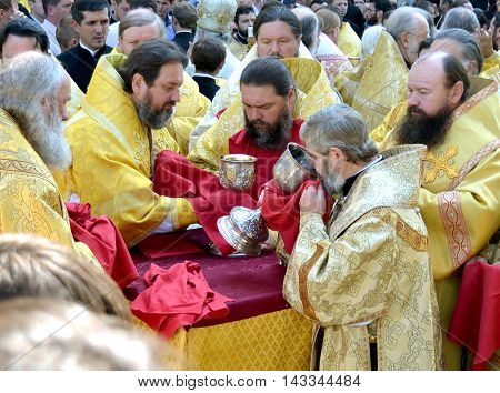 Kiev Ukraine celebration liturgy in honor of the baptism of Rus in Kiev Pechersk Lavra - 27 July 2013 -: Many priests partake and participate in the Eucharist at the celebratory liturgy