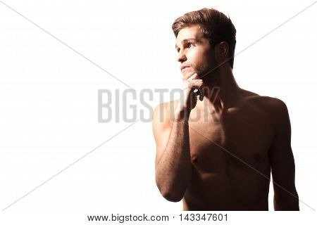 Hunky and handsome. Sexy muscular torso of young man isolated on white background in studio
