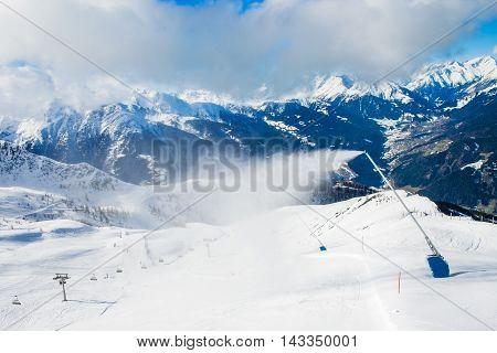 Snow machines make artificial snow in mountain ski resort Kals-Matrei, Austria.