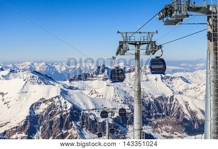 Snowy winter landscape and cable cars in the Alps