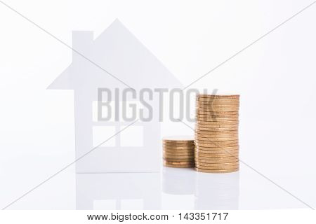 business advertisement family home concept and growing pile coin money for home finance and banking concept