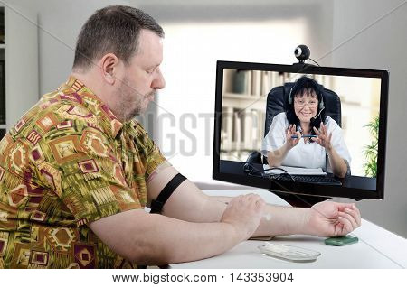 Virtual female doctor gives intravenous injection in the arm of male patient wearing silk Hawaiian shirt with short sleeve. Doctor in headset and white uniform asks middle-aged bearded man to follow her instructions carefully and slowly