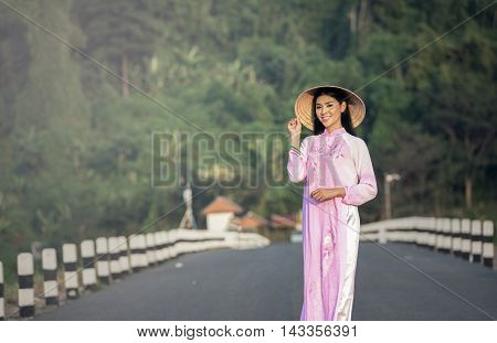 Portrait of Thai girls with Ao Dai Vietnam traditional dress Ao dai is famous traditional costume for woman in VIetnam.