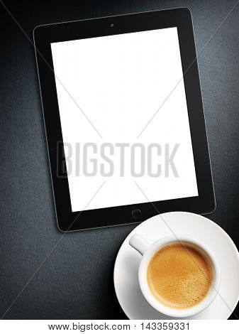 tablet white screen similar to ipad display and coffee on background