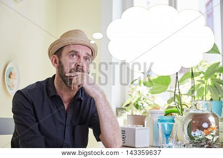 Man Brooding With A Thought Bubble Over His Head